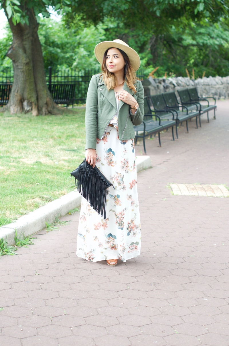 Lisa Rosado wearing floral maxi dress, black fringe clutch, moto jacket & swedish hasbeens peep toe heels