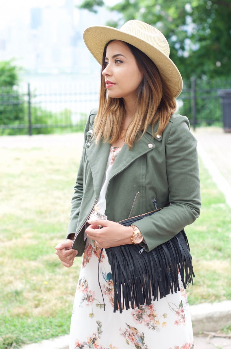 Lisa Rosado outfit details. Wearing Army Green Moto Jacket, Floral Dress by Lisa and Lucy, Free People Straw Hat and Oasis Fringe Bag